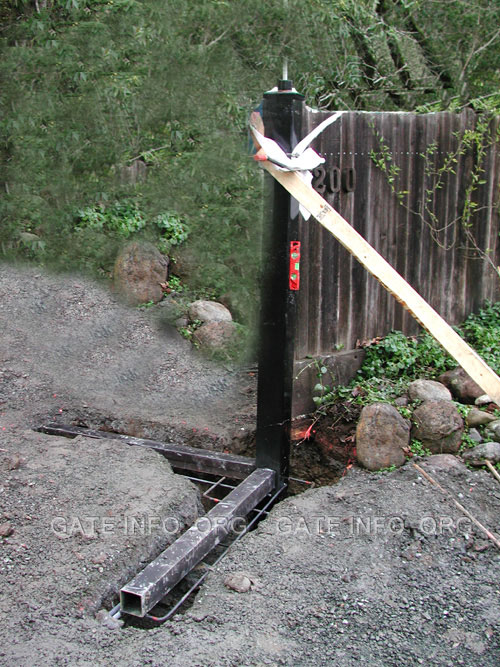 Post outrigger diagram and photo for How to build a driveway gate